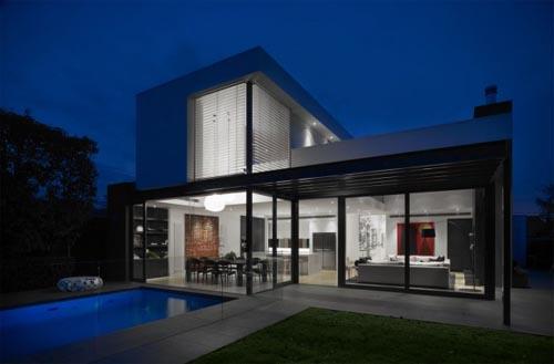 Modern White Interior Design Night View DMH Residence In Melbourne